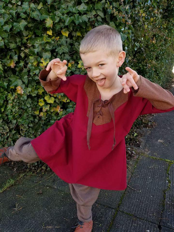 A red and brown boys tunic. ...