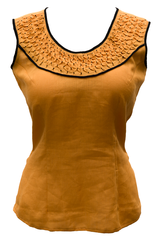 I made this top (IL020 Autumn Gold softened) with hand-smocking on a bias strip in the yoke. To ...