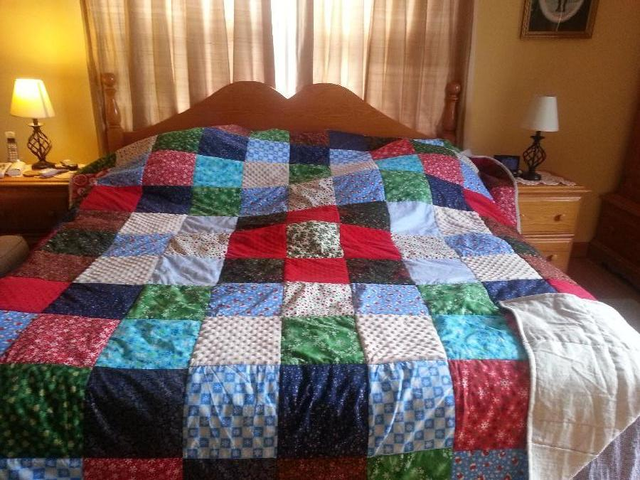 I made a Christmas quilt for my grandson who is always hot with Christmas squares on the front a...