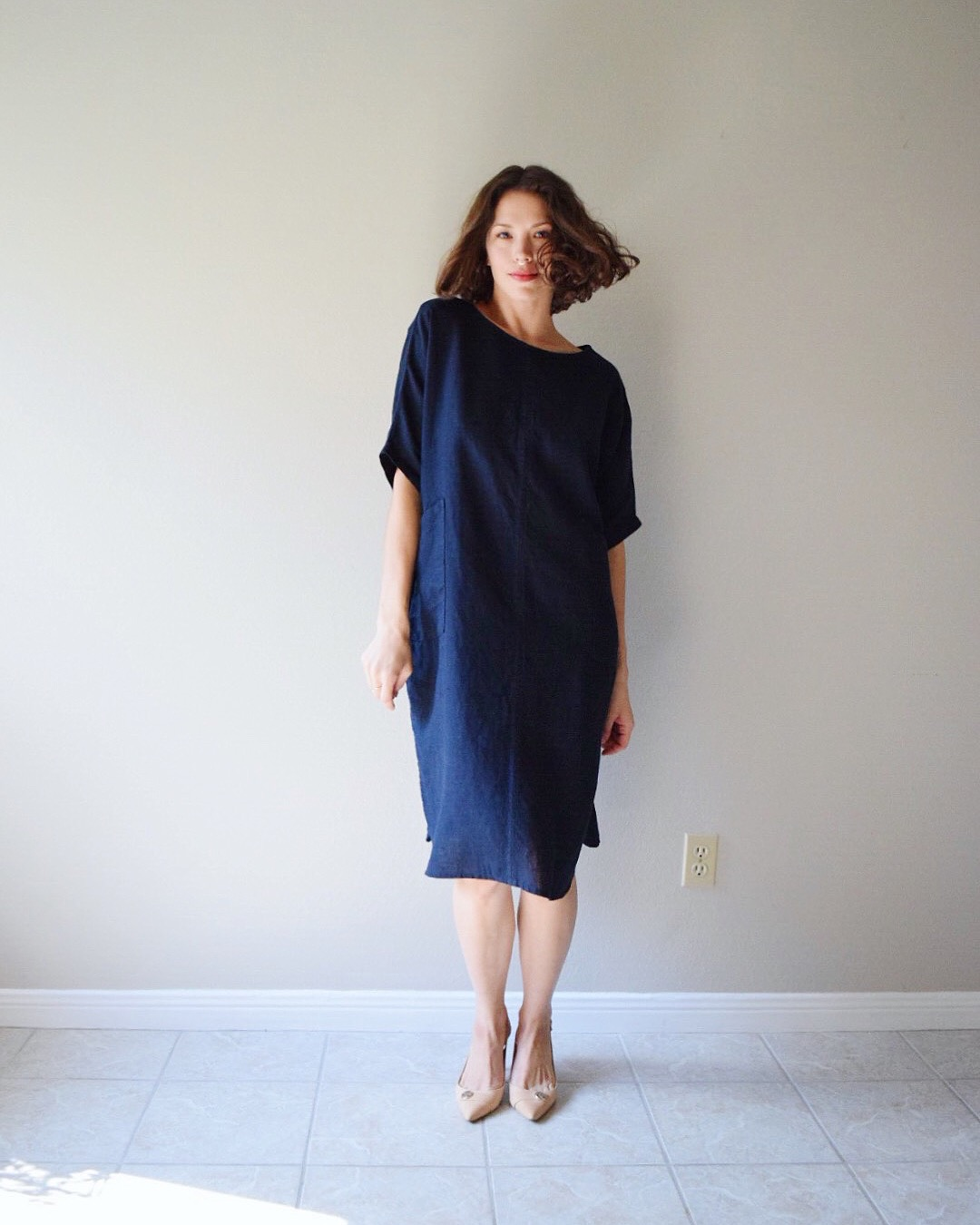 Shirt dress with center seam, rounded hem and oversized pockets - made with medium weight Dress ...