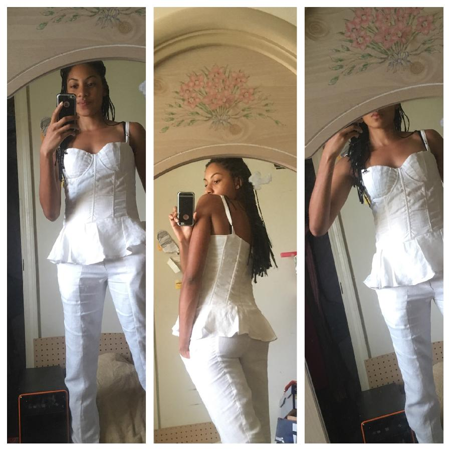 A detailed view of my white shelled bustier top with matching slim fit pants.