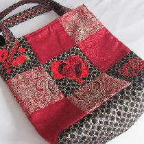 Fashion glamour tote. Brocade, shimmer, and quilted fabrics, fully lined, embellished with custo...