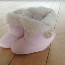 Cozy pink baby booties with Velcro closure...