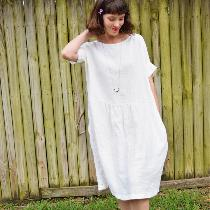 Gathered dress w inseam pockets and cuffed sleeves made with heavy weight bleached. ...