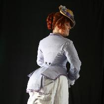 An 1880s day wear bustle gown...