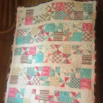 Crib size quilt made for a very special Lady for her baby girl. Free motion quilted it....