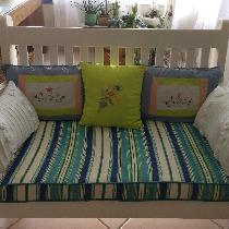 My mother is 90 years old and she loves embroidering. I sewed the cushions and she embroidered t...