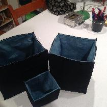 I used the tourquise linen to make the nesting fabric bins.  I love this fabric.  The texture an...