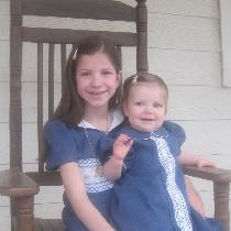 These are matching Easter dresses in Bluebonnet for my two daughters.  The older daughter's dres...