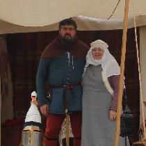 14th Century.  The lady  wears a 7 oz linen tunic, surcoat with rabbit fur trim in 7 oz linen.  ...
