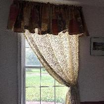 I made our dining room valance out of a 2 yard remnant I got at AC Moore. The curtain is decorat...