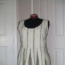 Yarn dyed stripe linen tunic with box pleats....