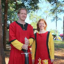 12th century Germanic paired tunics for him and a 13th century sideless surcoat with griffin app...