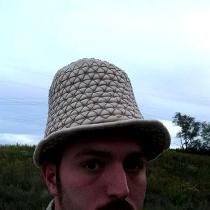 A handsewn armored hat made in linen canvas and lined in more linen with over 300 steel plates s...