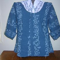 A pretty shade of blue linen was hand printed in a white pattern and sewn into an 18th century s...