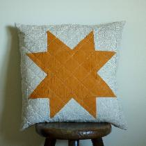 Dyed cotton star with Marigold flowers, on a backdrop of quilted mix-natural linen ( my favourit...