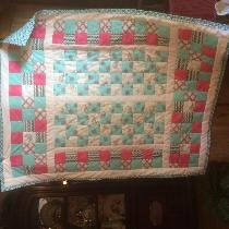 throw cover size girls quilt for a special little girl finished it with in the ditch....