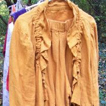 This is a crop jacket and pantaloons made from the color autumn gold and a dress made with the r...