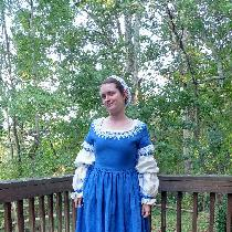 This is a recreation of a 17th century gown. The blue is the aquamarine linen heavy weight and t...