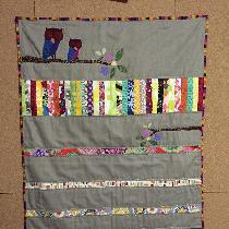 This is a baby quilt made with medium weight linen.  It is my own design and I also used scraps ...