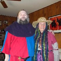 Two 11th century tunics, done in parti-colored linen, for an SCA event; worn by my mother and I....