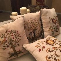 Hand embroidered pillows for my kitchen chairs. Love the fabric store linen. Bleached linen soft...