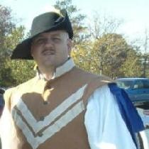 My Dashing Husband in a Doublet and pants I made quite a few years ago....