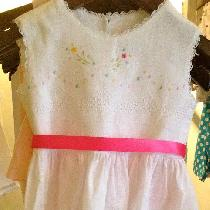 This dress is handmade in handkerchief linen. It has been finely hand embroidered with flowers i...