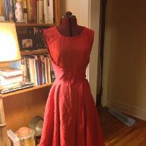 I used a bright red linen to make this reproduction vintage dress from a 1950 pattern.  It featu...