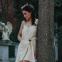 100% linen Roman Draped Mini Dress, featuring a folded asymmetrical front seam and hidden triang...