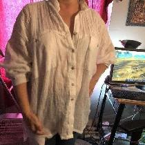 Very loose fitting bleached lined shirt. Dropped yoke has tiny tucks stitched across the width. ...