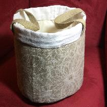 Linen buckets for bathroom towels, soaps and guest items.  The jacquard linen used on the main b...
