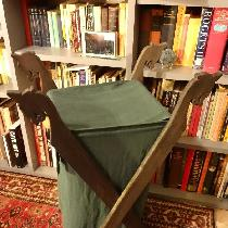 Viking Laundry Basket realized in medium weight green linen.  Dragon supports are adapted from t...
